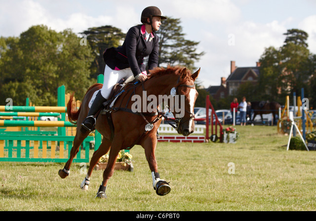 A competitor in the show jumping event at the Bucks County Show 2011. - Stock Image
