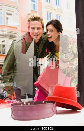 Couple window shopping - Stock Image