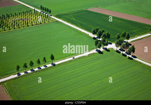 The Netherlands, near Den Bosch, road crossing in farmland. Aerial. - Stock Image