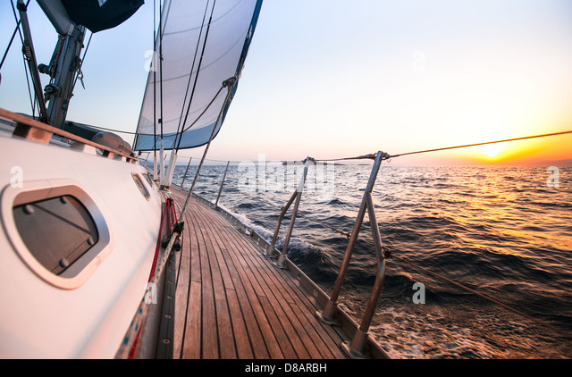 Sailing regatta in Greece, during sunset. - Stock Image