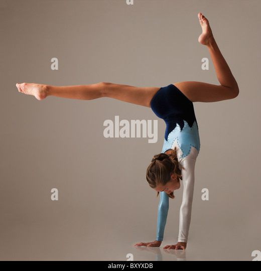 Female gymnast performing handstand - Stock Image