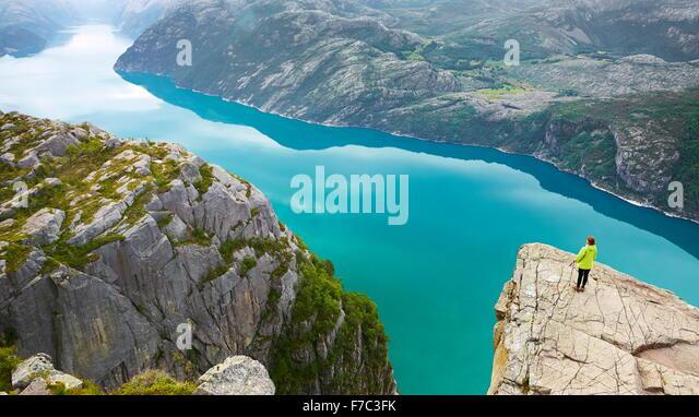 Single tourist at the Lysefjorden (near Preikestolen), Norway - Stock Image