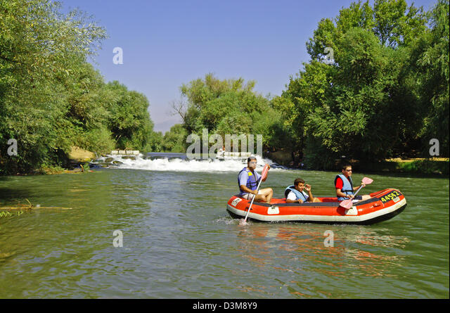Israel, Upper Galilee, Rafting in the Jordan river - Stock Image