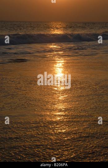 sunset at a kerala beach - Stock Image