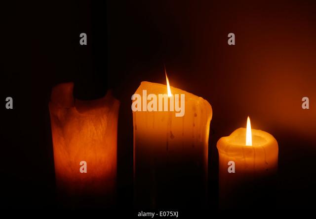 Three candles burning - Stock Image