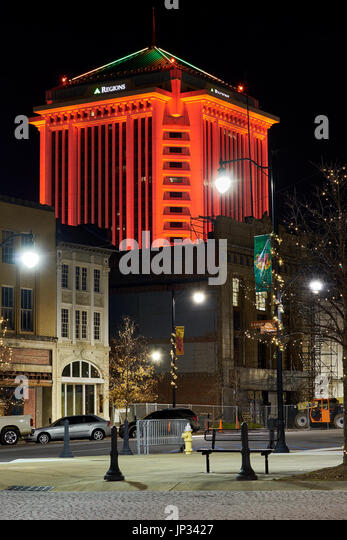 Regions Bank building in Montgomery, Alabama lit up with colorful red lights during the Christmas season. - Stock Image
