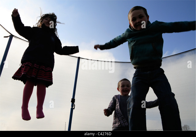 Children jumping with joy - Stock Image