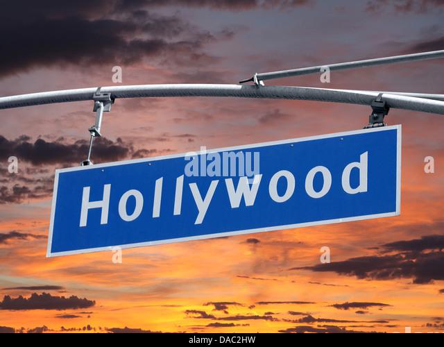 Hollywood Blvd street sign with orange sunset sky - Stock Image