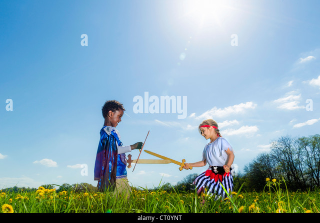 Boys playing dress up outdoors - Stock Image