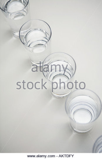 Glasses of water in a row - Stock Image