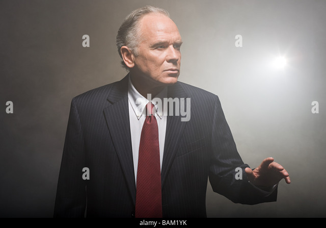 Businessman in smoke - Stock Image
