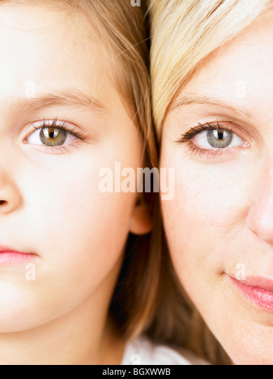 Mother and daughter looking at camera - Stock Image