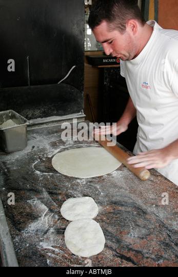 Saint Martin Marigot French Port la Royale pizza maker dough roller - Stock Image