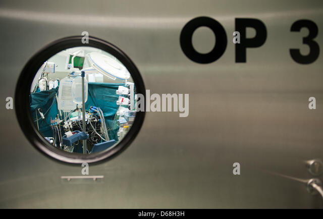 View of the door to an ORwhere a team of doctors operates ona  patient at the German Heart Institute in Berlin, - Stock Image