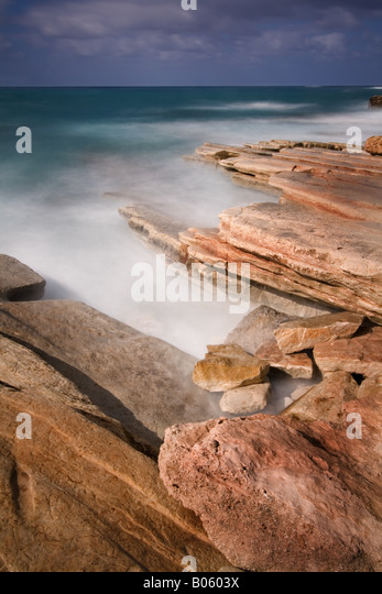Rock strata off the coast from Geronisos Island, Cyprus. - Stock Image