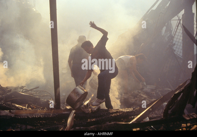 Family salvaging possessions after riots South Central Los Angeles California - Stock Image