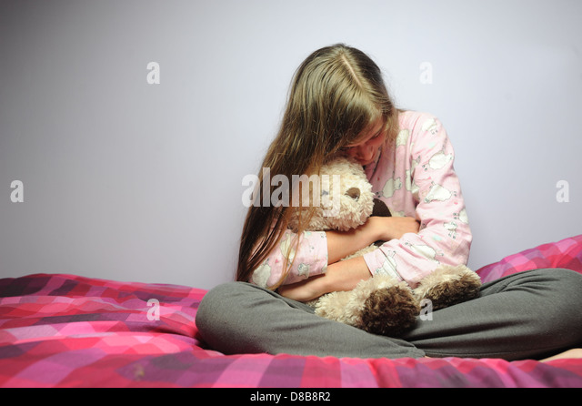 A depressed stressed out teenage girl in her bedroom. - Stock Image
