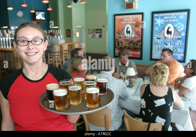 Virginia Ashburn Old Dominion Brewing Company waitress beer samplers - Stock Image