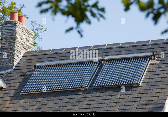 Solar water heaters on a house roof near Loughborough Leicestershire UK - Stock Image