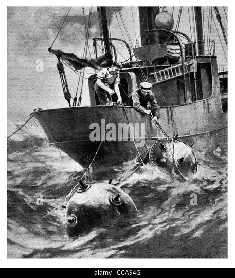 1917 2 sailors trawler cutting mines free mine explosive danger explosive explosives ship high seas ocean fishing - Stock Image
