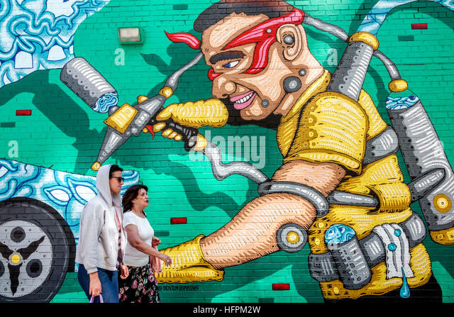 New York New York City NYC Manhattan Chelsea street art mural Denton Burrows Andy Golub collaborative mural pedestrians - Stock Image