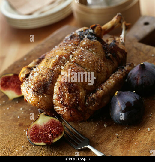 Duckling stuffed with figs and duck foie gras - Stock Image