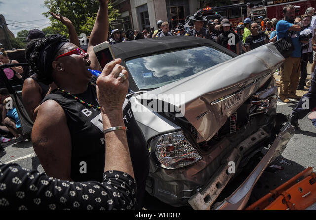 Charlottesville, Virginia, USA. 12th Aug, 2017. a group of anti-white supremacist protesters injured by a car slammed - Stock Image