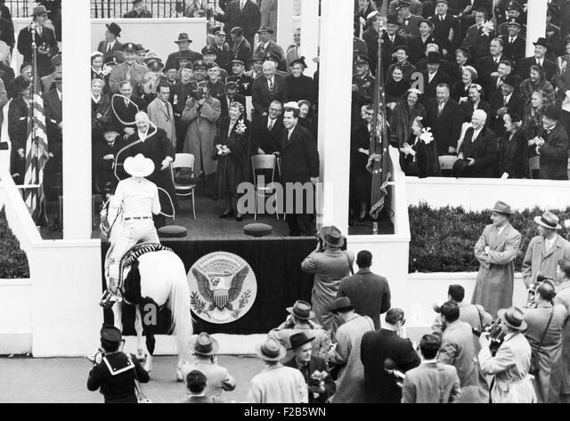 Cowboy Monte Montana tosses his lariat over President Dwight Eisenhower. Montana was rodeo trick rider, actor, stuntman - Stock Image