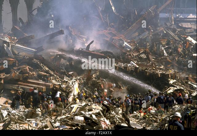 Firemen sprays still burning ruins of the World Trade Center on Sept 16, 2001. In upper right are ruins of WTC 3, - Stock-Bilder