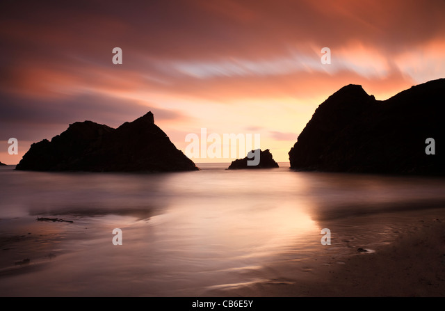 The dramatic cliffs at Soar Mill Cove in Devon, UK, silhouetted against the sunset - Stock Image