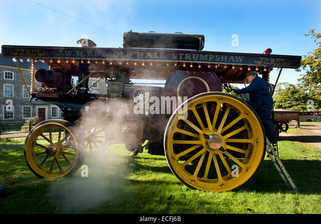 Steam surrounds owner Chris Spinks's Charles Burrell & Sons 1920 Showmans Traction Engine 'Princess - Stock Image