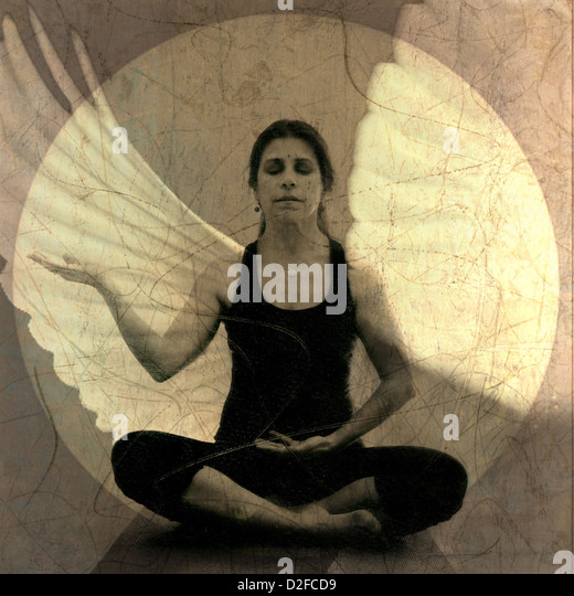 Woman in receptive yoga mudra meditation pose with wing overlay. - Stock Image