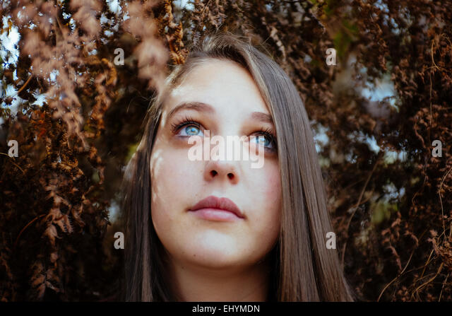 Portrait of a teenage girl outdoors - Stock Image