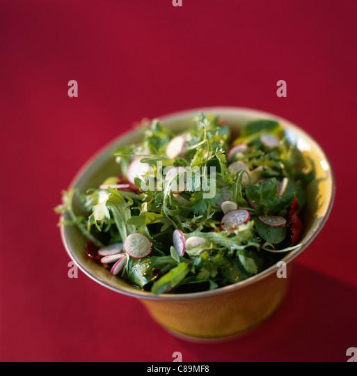 Mixed fresh salad with radishes - Stock Image