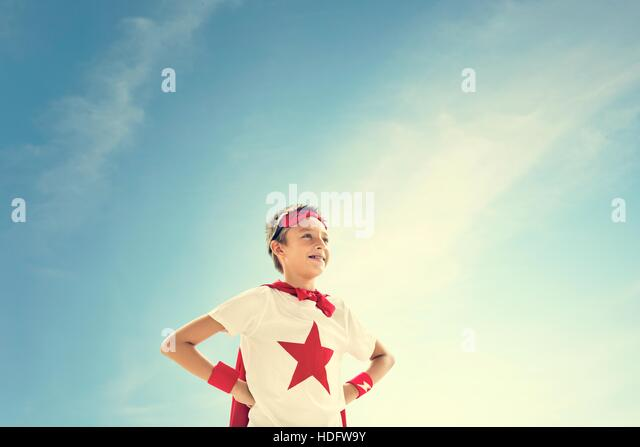 Superhero Boy Imagination Freedom Happiness Concept - Stock Image