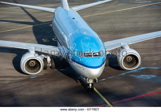 Amsterdam Schiphol KLM Boeing 737 taxiing to its gate. - Stock Image