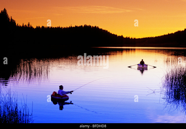 Flyfishing at sunset on Lac des Roches, British Columbia, Canada - Stock Image