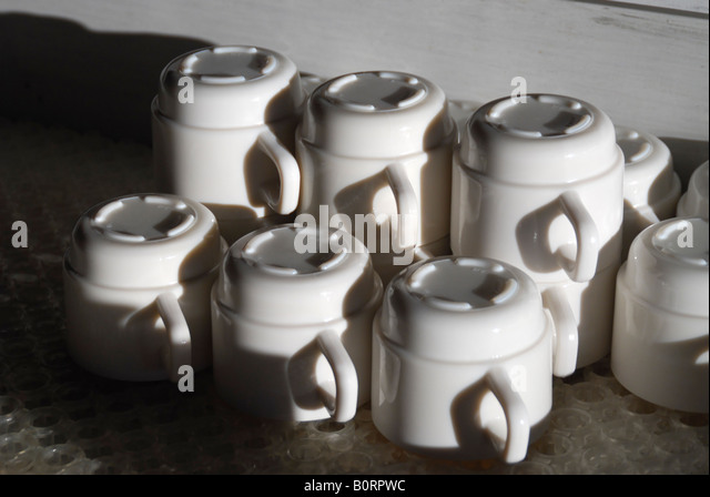 The range of the reversed coffee cups - Stock Image
