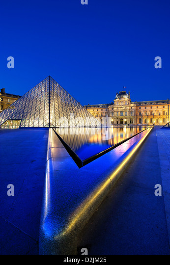 The Louvre at night Paris France - Stock Image