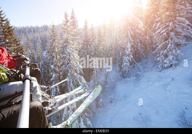 family sitting in ski lift - Stock Image