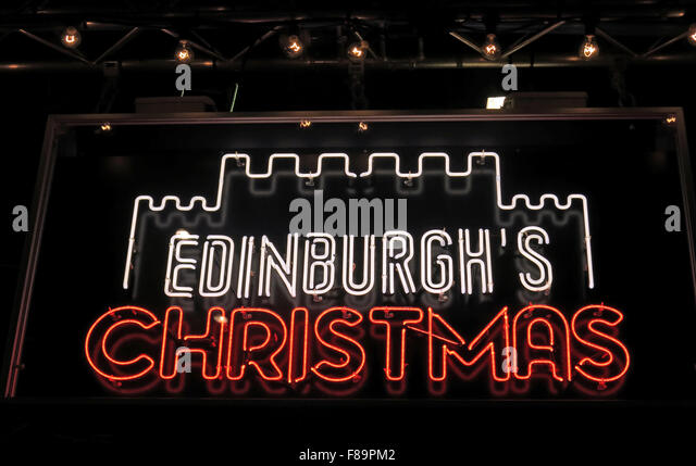 Edinburghs Christmas neon sign at night,Princes St,Scotland,UK - Stock Image