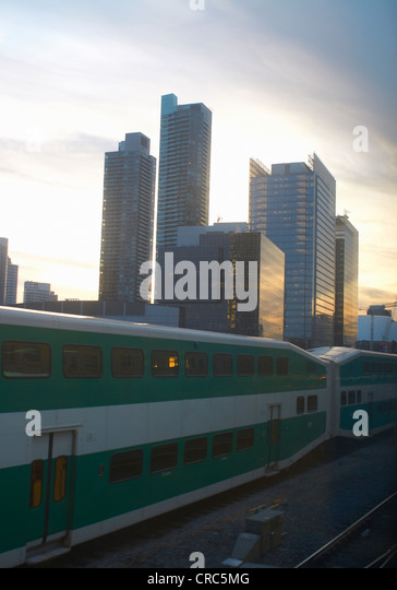 Train passing by Toronto city skyline - Stock Image