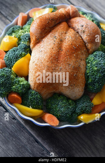 Thanksgiving turkey with spices and vegetables on the wooden table - Stock Image
