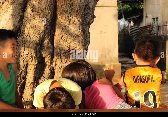Shy kids in Mabini, Philippines - Stock Image