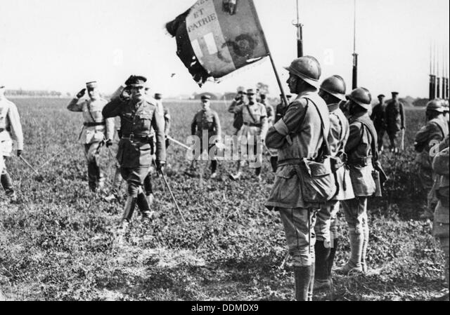 Field Marshal Sir Douglas Haig saluting an Infantry flag, WWI, c1914-c1918. - Stock Image