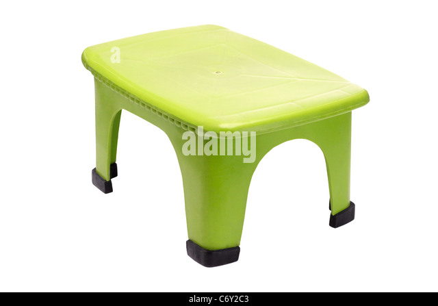 Small green plastic stool on white background - Stock Image