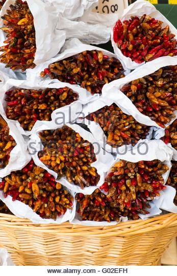 Bunches of dried chillies for sale, Venice, Italy, April - Stock-Bilder