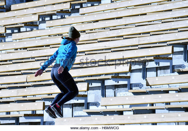 Jump. Woman jumping on stairs. - Stock Image