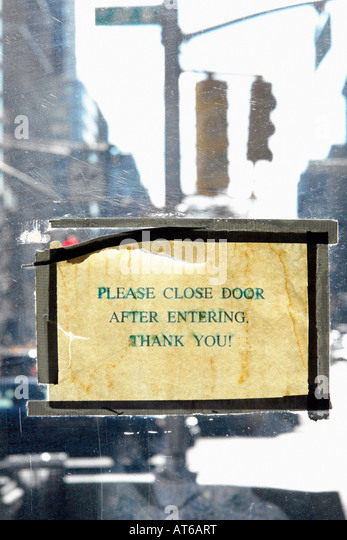Please Close Door After Entering Thank You Sign on a Door - Stock Image