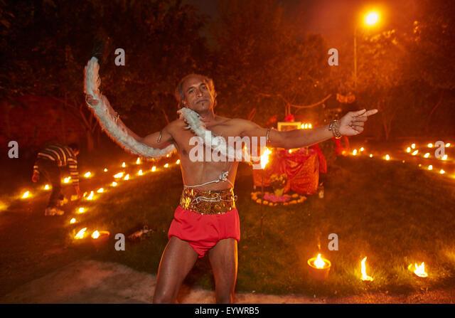 Devotee impersonating the Hindu god Hanuman, Diwali festival at the Sarcelles ISKCON temple, Sarcelles, Val d'Oise, - Stock Image